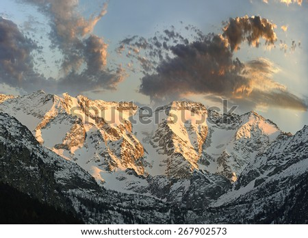 Group Adamello mountain at sunset, view from the valley Camonica, Natural Park Adamello, Alps, Italy