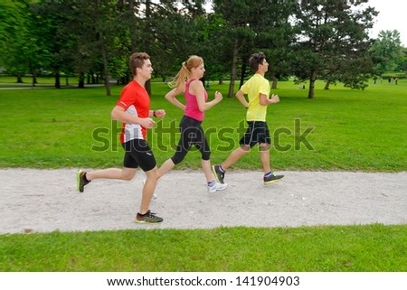 Group of athletes jogging in the park