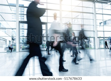 Group of Business People Walking at a Exhibition
