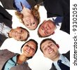 Group of 5 businesspeople in a circle looking down, unity and teamwork concept, low angle shoot - stock photo