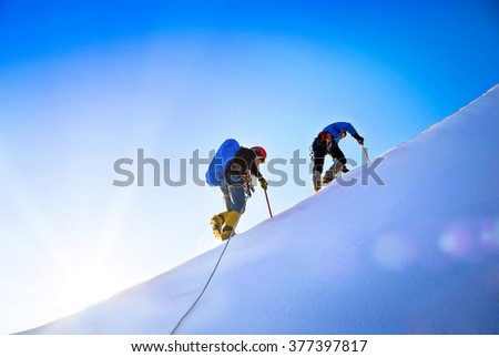 Group of climbers reaching the summit. Extreme sport concept