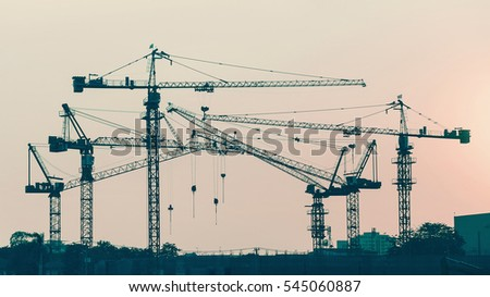 group of construction tower crane in vintage tone color with sunset sky background