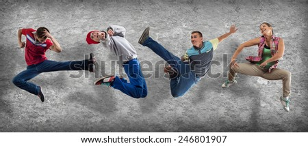 Group of dancer in jump on cement background