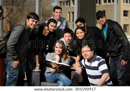 Group of diverse students inside college campus