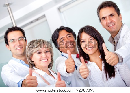 Group of doctors with thumbs up at the hospital