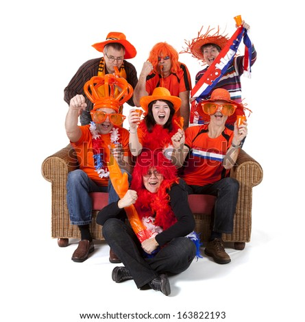 Group of Dutch soccer fan watching game over white background