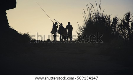 Group of Fishermans silhouette at sunrise