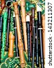 Group of flutes of different types, colors and sizes on a  bright colorful tablecloth at the flea market in Tel Aviv. Useful for background. - stock photo