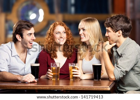 Group of friends at a bar.