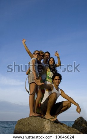 Group of friends on tropical beach