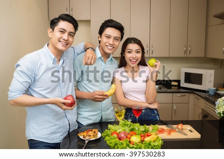 Group of friends preparing dinner together