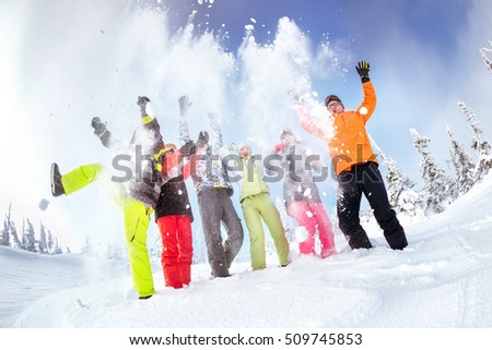 Group of friends skiers and snowboarders having fun at ski resort Sheregesh. Siberia, Russia