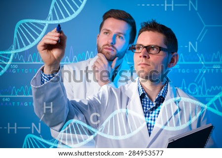 Group of geneticists working at media screen. Genetic engineering