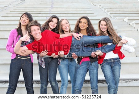 group of girls carrying a lucky boy