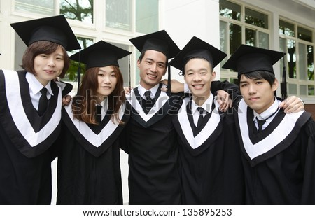 Group of graduate students standing outdoors smiling