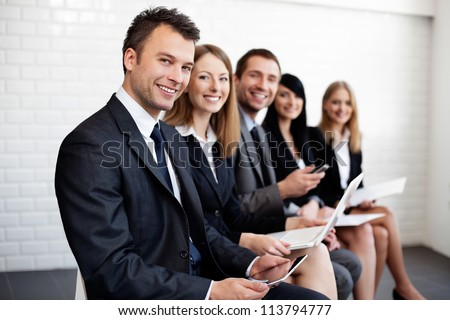 Group of happy business people sitting.
