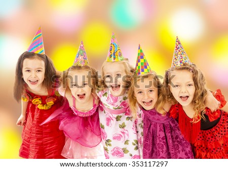 Group of happy children dancing at the carnival