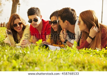 Group of happy college students outside