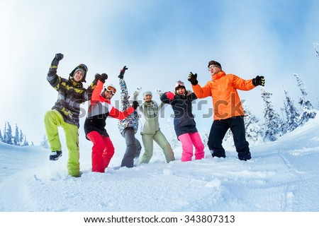 Group of happy friends having fun on the mountains top, Sheregesh resort, Siberia Russia