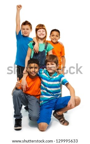 Group of happy smiling kids standing together - boys and girls black and Caucasian