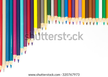 Group of multi colour wooden pencils on white background
