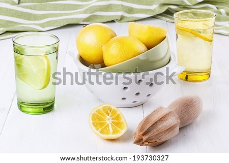 Group of organic lemons and lemonade over white wooden background