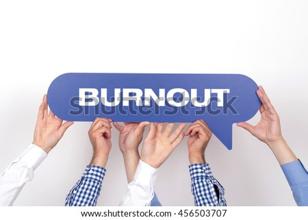 Group of people holding the BURNOUT written speech bubble