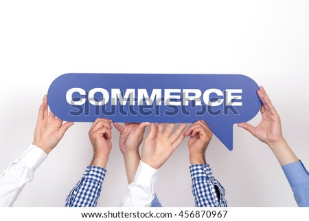Group of people holding the COMMERCE written speech bubble