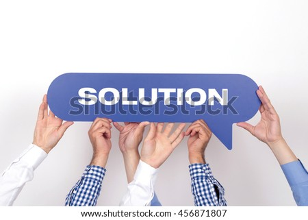 Group of people holding the SOLUTION written speech bubble