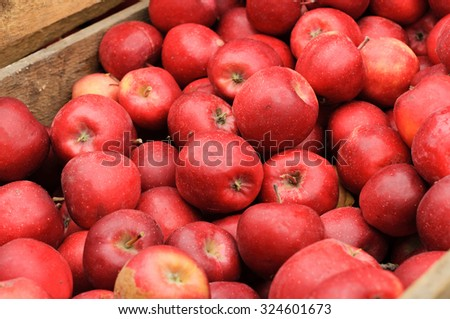 Group of red apples in a wooden box