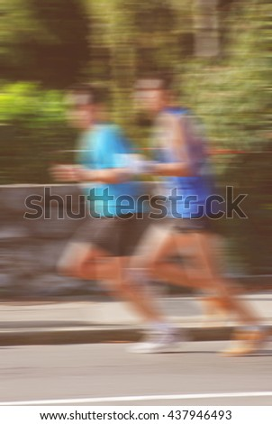 group of runners, blurred motion