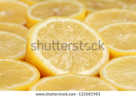 Group of sliced lemons forming a background