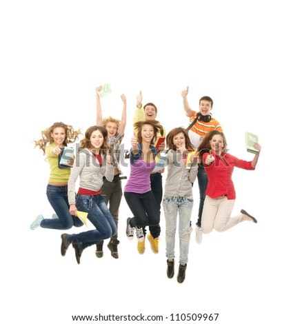 Group of smiling teenagers jumping together and looking at camera isolated on white