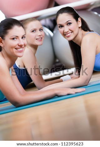 Group of sport women have a rest in the gym centre