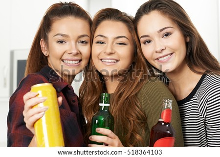 Group Of Teenage Girls Drinking Alcohol At Party