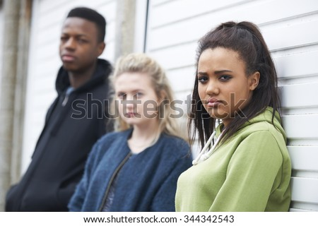 Group Of Teenagers In Urban Environment