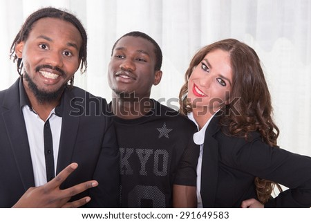 group of two africans and one caucasian girl