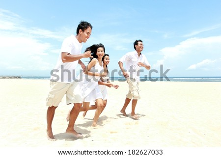 Group Of young Friends Enjoying Beach Together