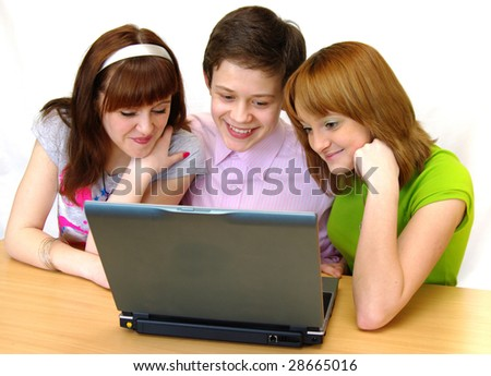 Group of young students - pupils having fun on laptop