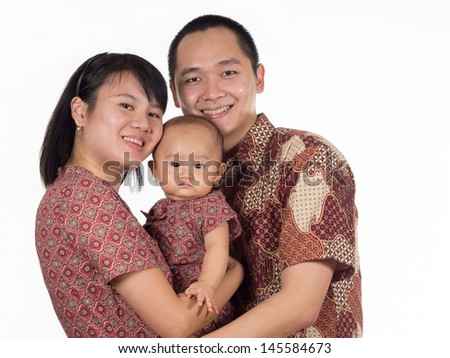 Group picture of young family wearing Indonesian traditional national clothing know as batik