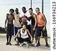 Group portrait of a street basketball team - stock photo