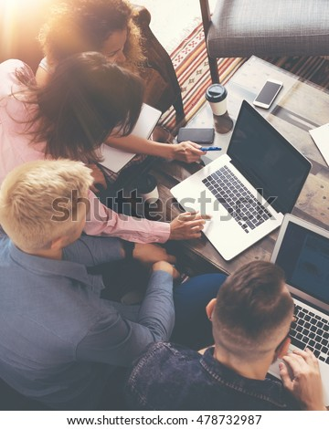 Group Young Coworkers Making Great Business Decisions.Creative Team Discussion Corporate Work Concept Modern Office.Startup Marketing Idea Presentation.Woman Touching Digital Laptop.Top View.Vertical