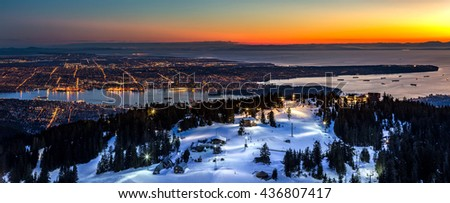 Grouse Mountain ski resort overlooking Vancouver city at sunset