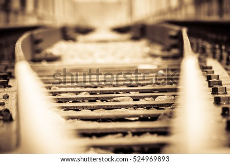 Grunge old railroad tracks close up background.