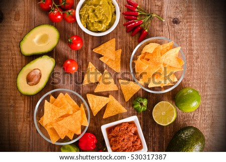 Guacamole and nacho chips.