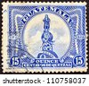 GUATEMALA - CIRCA 1926: A stamp printed in Guatemala shows Columbus Monument , circa 1926. - stock photo