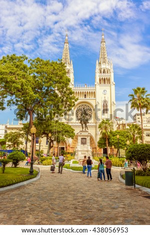 Guayaquil, Ecuador - April 16, 2016: People visiting Statue of Simon Bolivar in Parque Seminario, Parque Bolivar or Parque de las Iguanas. It is located in front of Metropolitan Cathedral church.