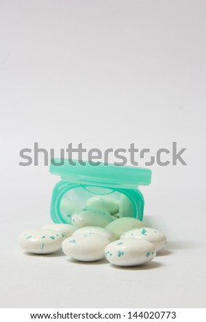 Gum from green gum box and white background