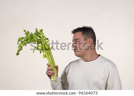 Guy not too pleased with his vegetables