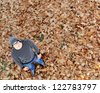 Guy standing on fall leaves with copy space - stock photo